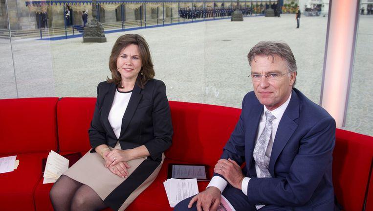 Presentatoren Astrid Kersseboom en Rob Trip in het glazen huis van de NOS op de Dam tijdens de inhuldiging van koning Willem-Alexander. Beeld ANP Kippa