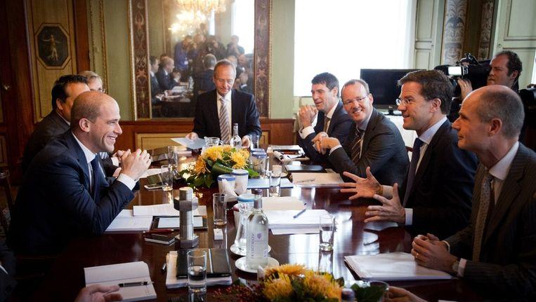 De onderhandelaars aan tafel. Beeld anp