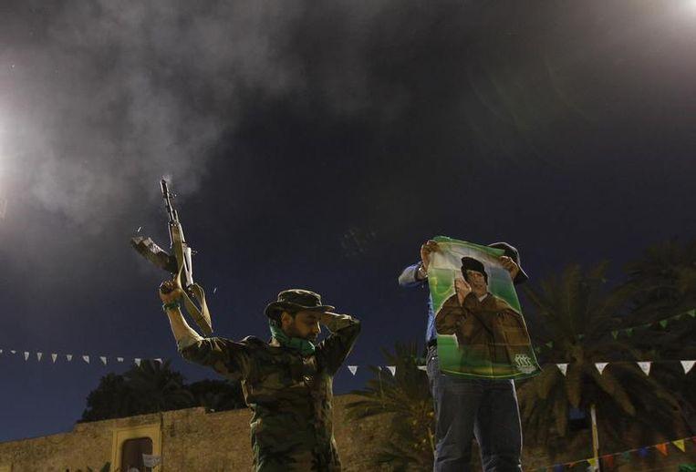 Soldaten van Kadhafi in Tripoli. Beeld reuters