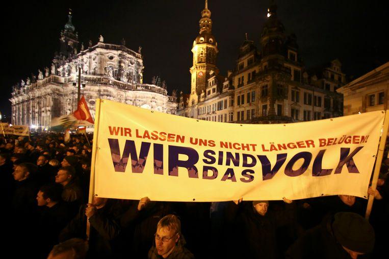 De optocht van Pegida (Patriottische Europeanen tegen de islamisering van het Westen) vorige maand in Dresden. Beeld REUTERS