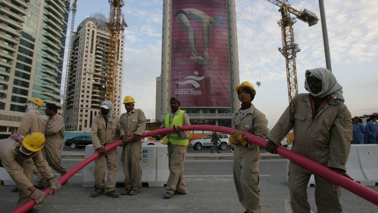 Constructiewerkers in Doha, de hoofdstad van Qatar. Beeld AFP