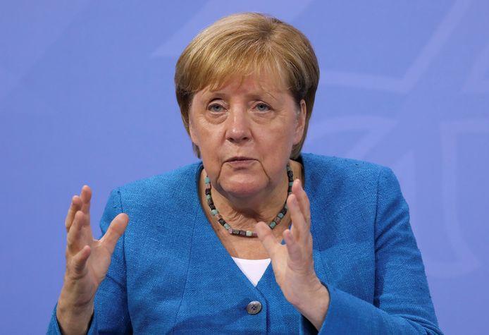 Bondskanselier Angela Merkel tijdens de persconferentie na afloop van het coronaoverleg.