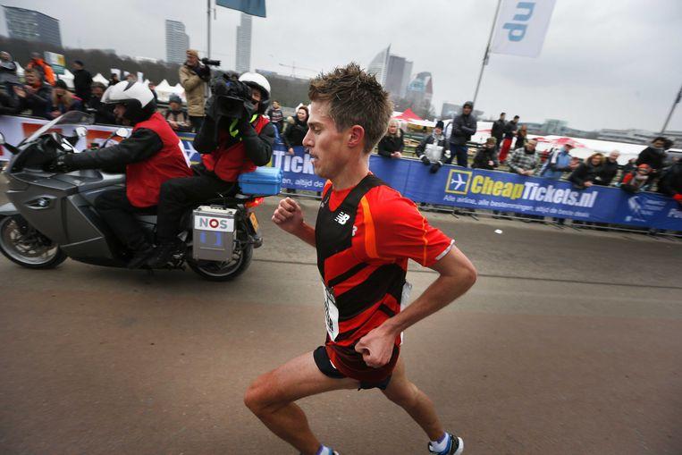 2013-03-10 DEN HAAG - Michel Butter tijdens de City Pier City loop. Butter kwam als eerste Nederlander over de finish op het Malieveld ANP CATRINUS VAN DER VEEN. Beeld ANP