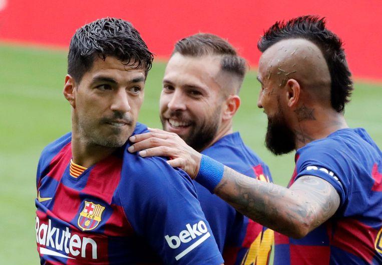 Luis Suárez viert een van zijn twee goals tegen Celta de Vigo. Beeld EPA