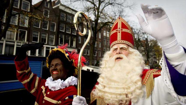 Sinterklaas en Zwarte Piet. Beeld anp