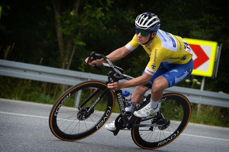 Remco Evenepoel in actie tijdens de Ronde van Polen, die hij won. 'Remco lijkt een kind in een speeltuin, maar het draait om presteren en winnen bij hem' , zegt ex-trainer Fred Vandervennet. Beeld Photo News
