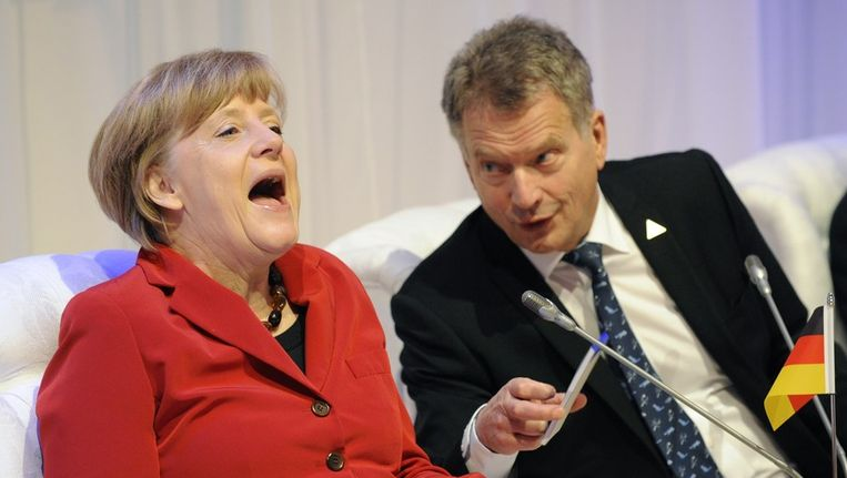 De Duitse bondskanselier Angela Merkel (links) en de Finse president Sauli Niinisto. Beeld afp
