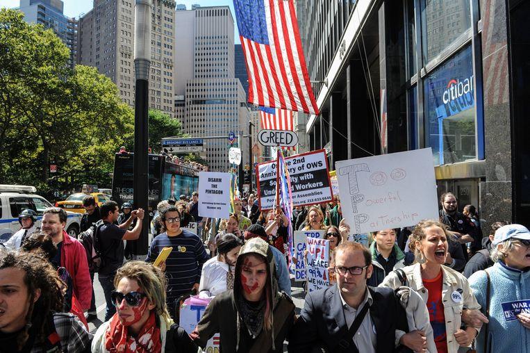 Het anti-Trump-protest putte inspiratie uit onder meer de Occupy Wall Street-beweging.  Beeld Photo News