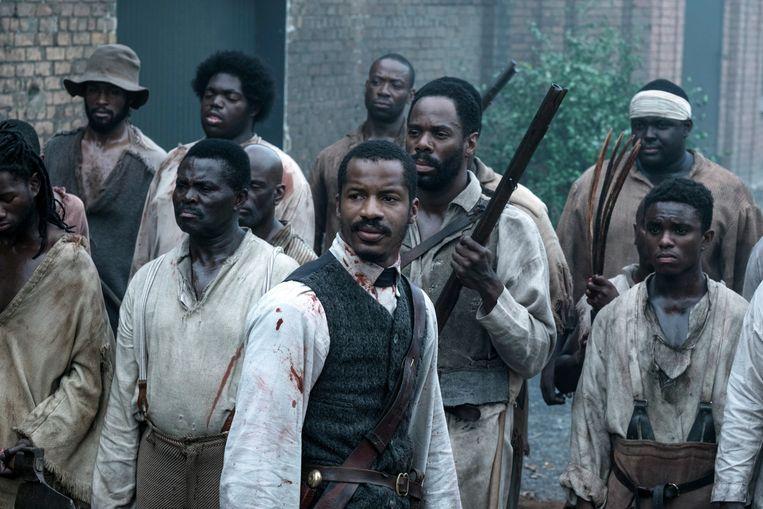 ► Nate Parker (m.) als slavenrebellenleider Nat Turner. Beeld AP