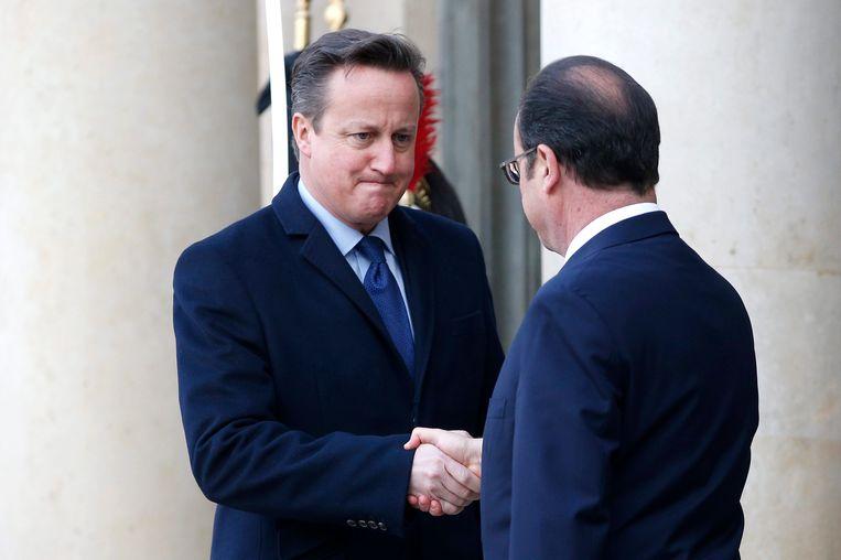 De Britse premier David Cameron (L). Beeld null