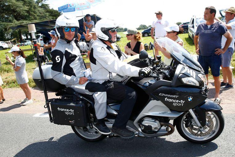 Voeckler aan de slag op de moto voor France Télévision.