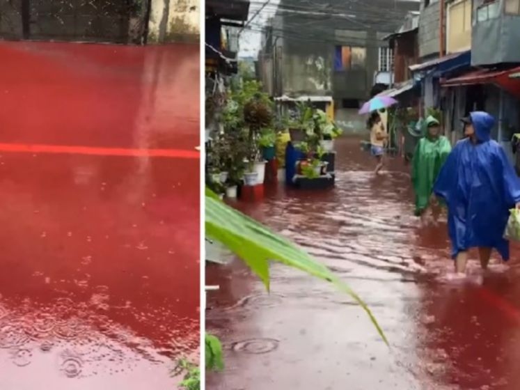 Water van Tyfoon kleurt rood in Filipijnen
