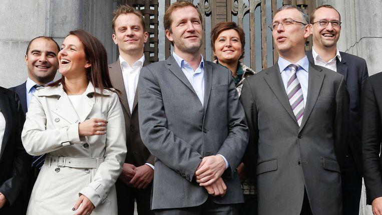 Philippe Van Cauwenberghe hier in betere tijden rechts op de foto met toekomstig burgmeester Paul Magnette. Beeld BELGA