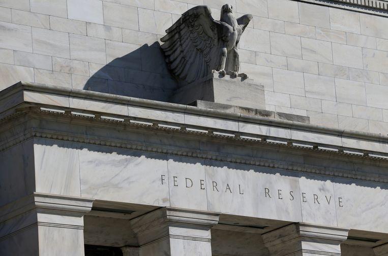 Opnieuw verlaagt de Fed de rente. Ook herstart het een opkoopprogramma van obligaties. Beeld REUTERS