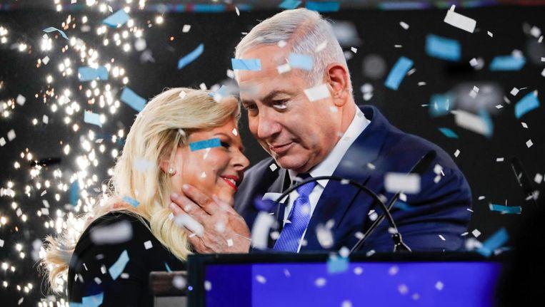 Netanyahu en zijn vrouw vieren de overwinning al. Beeld afp