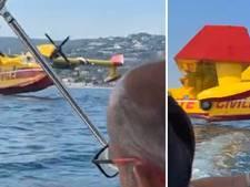 Familie in bootje ontsnapt maar net aan blusvliegtuig