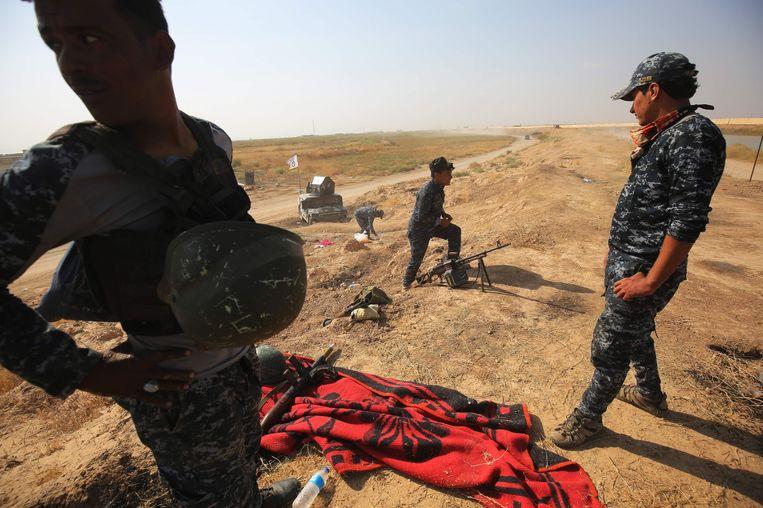 Iraakse soldaten in de omgeving van de stad Kirkuk. Beeld afp