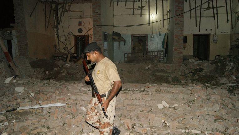 Verwoest gebouw bij eerdere bomaanslag Pakistan Beeld ANP
