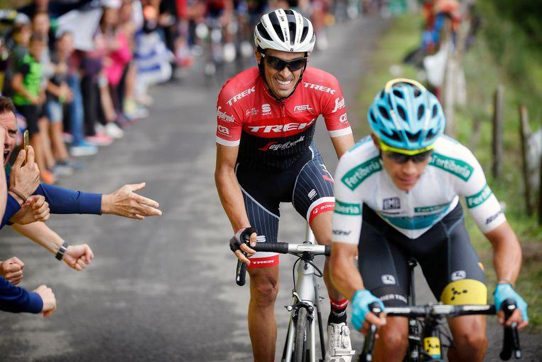 Zelfs voor fladderaars als Alberto Contador en Miguel Angel Lopez was het woensdag grimassen trekken op de steile slotklim naar Alto de los Machucos.  Beeld Photo News