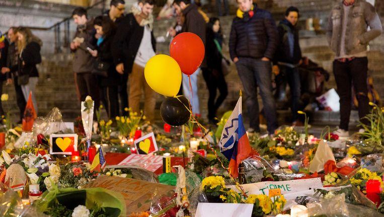Eerbetoon aan de slachtoffers van de aanslagen in Brussel op 25 maart 2016. Beeld Photo News