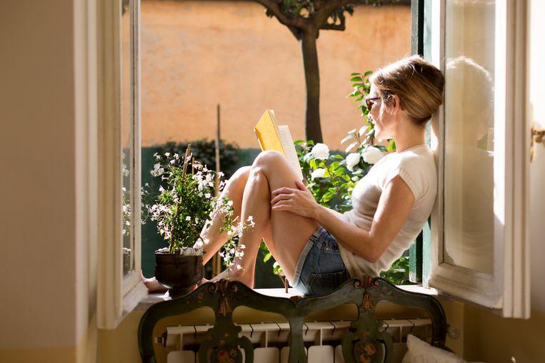 Boek lezen in de zomer Beeld Getty Images