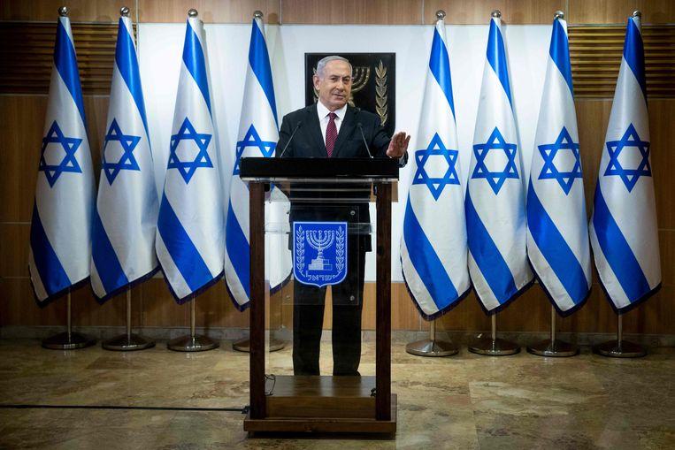 de Israëlische premier Benjamin Netanyahu spreekt de Knesset (Israëls parlement) toe. Beeld AFP