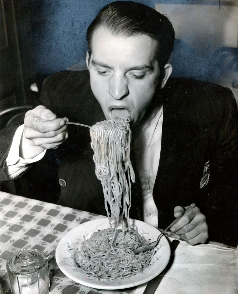 Phillip J. Stazzone is on WPA and Enjoys His Favorite Food as He's Heard That the Army Doesn't Go in Very Strong for Serving Spaghetti Beeld Weegee