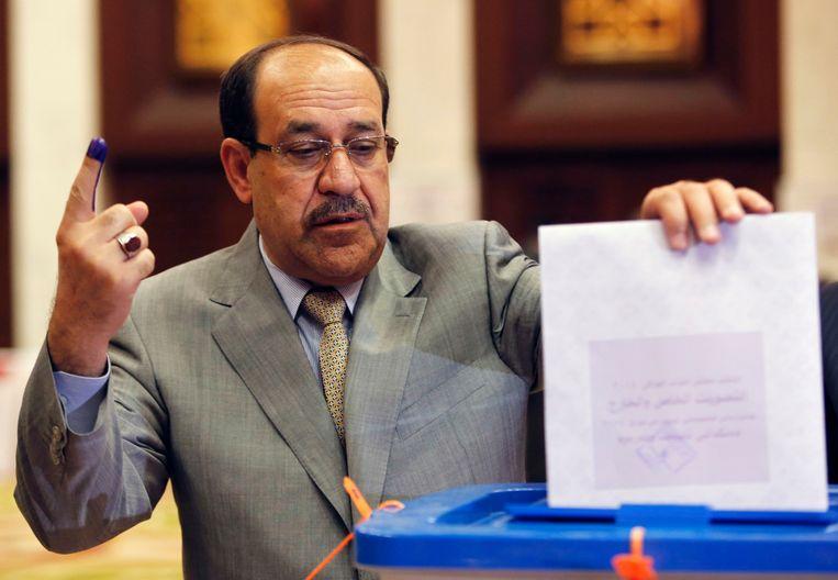 Al-Maliki stemt tijdens de parlementsverkiezingen, eind april. Beeld REUTERS
