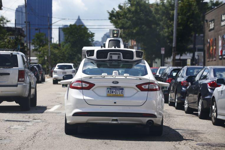 Met een zelfrijdende taxi wordt Uber concurrent van Google Beeld ap