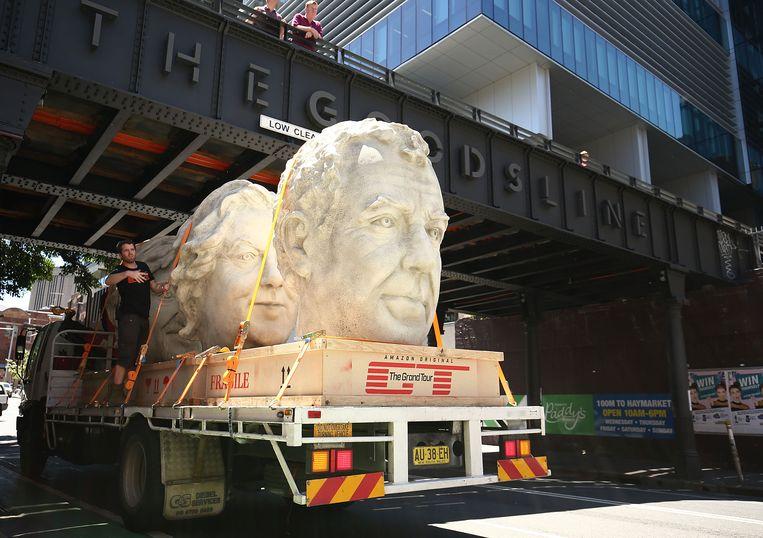 De stenen hoofden van Clarkson en co rijden rond in Sydney Beeld rr