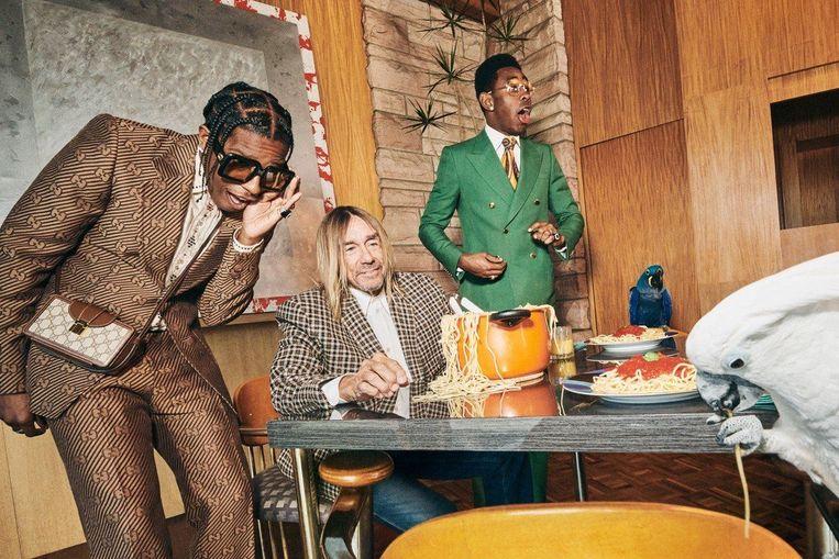 'Mensen zeggen dat geld geen geluk koopt. Geld koopt wél geluk, alleen telkens niet heel erg lang.' (Foto: in een Gucci-reclamespot met A$AP Rocky en Iggy Pop.) Beeld Photo News