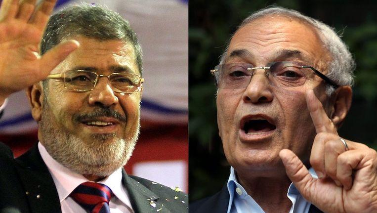 De presidentskandidaten Mohammed Mursi (l.) en Ahmed Shafiq (r.). Beeld EPA