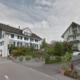 Zwitsers miljonairsdorp betaalt om vluchtelingen weg te houden