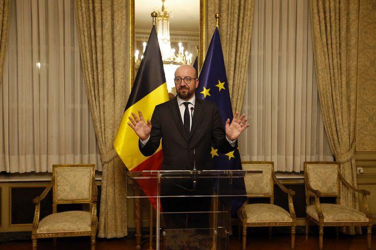 Premier Charles Michel tijdens de persconferentie op 8 december.  Beeld BELGA