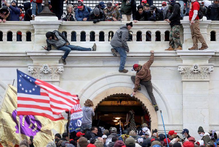 Aanhangers van Donald Trump tijdens de bestorming van het Capitool in januari. Beeld REUTERS