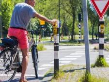 Waarom fietsers bij verkeerslichten soms onnodig op de knop drukken