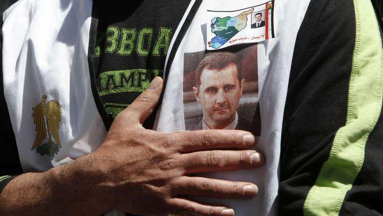 Aanhanger van president Assad. Beeld reuters