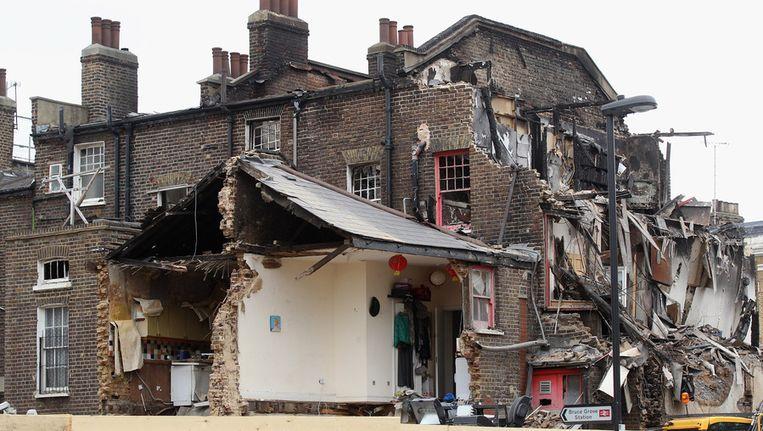 Verwoeste gebouwen na de rellen in Tottenham. Beeld getty