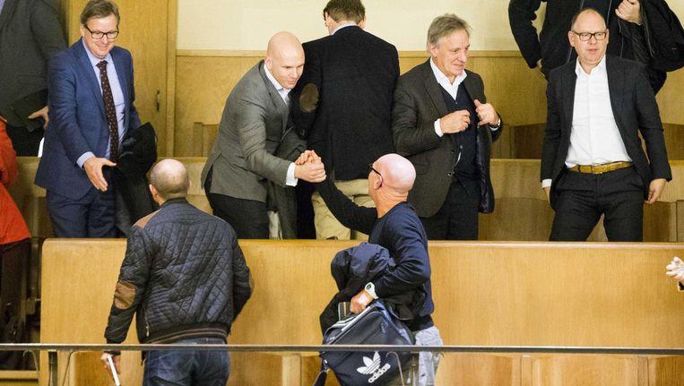 C Twente financieel directeur Erik Velderman, Jan van Halst, Koen Groenewold commissaris, en voorzitter Jan Schutrups (vlnr) op de publieke tribune tijdens de stemming in de gemeenteraad over de financiele garantstelling voor FC Twente. Beeld anp