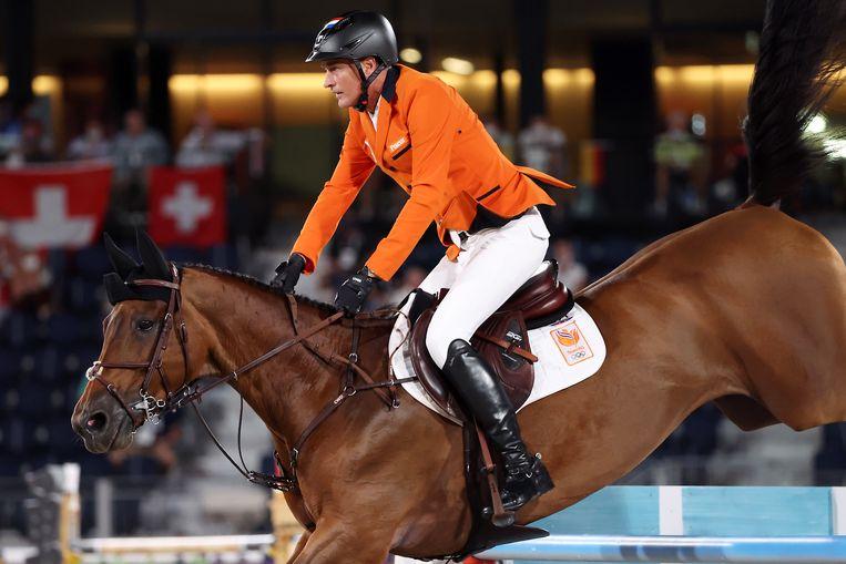 Marc Houtzager was met Dante de beste Nederlandse combinatie in de kwalificaties voor de landen.  Beeld EPA
