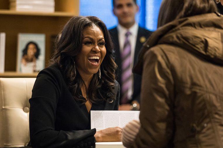Michelle Obama vorige week bij een signeersessie van haar boek in Chicago. Beeld AP