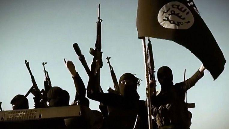 Archieffoto: strijders met de vlag van Islamitische Staat Beeld ANP