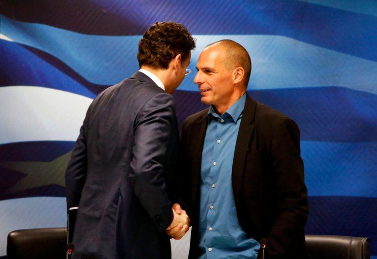 Dijsselbloem en de Griekse minister Varoufakis na een persconferentie in Athene, waarbij de spanning flink opliep. Beeld REUTERS