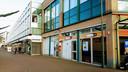 De leegstaande winkels in de Dr. Brabersstraat moeten wijken voor nieuwbouw.