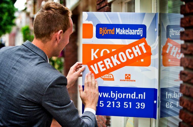 In Amsterdam waren huizenkopers het afgelopen jaar gemiddeld 484.995 euro kwijt aan een koopwoning. Beeld ANP