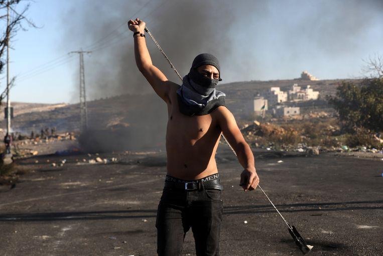 Een betoger in Ramallah. Beeld EPA