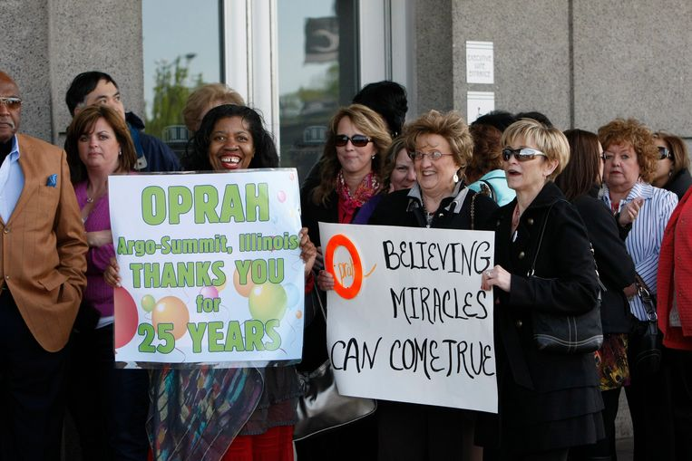 Fans react to the camera as they wait for  the taping of The Oprah Winfrey Show Tuesday, May 17, 2011, at the United Center in Chicago.