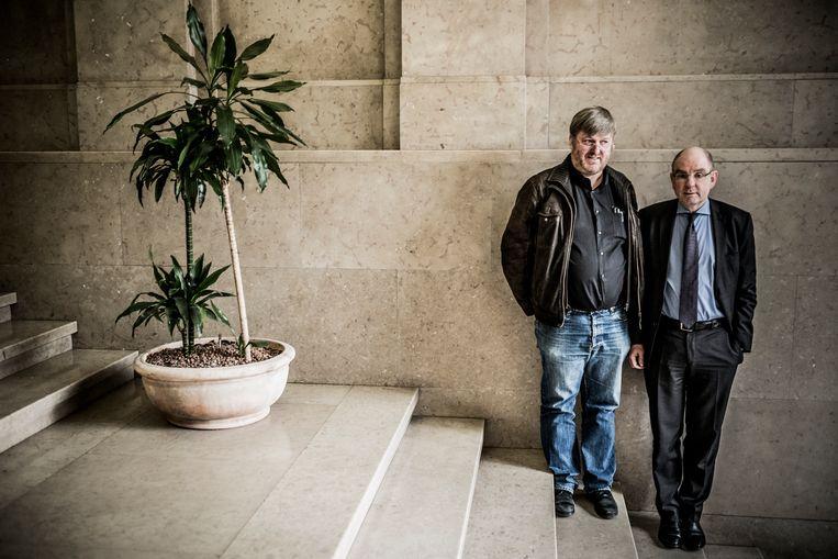Michel Jacobs (l): 'Wij zijn de verliezers.' 'Toch voel ik me geen winnaar', zegt Koen Geens. Beeld Diego Franssens