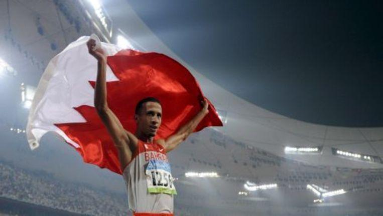 Rashid Ramzi uit Bahrein viert zijn medaille tijdens de Olympische Spelen in Peking. ANP Beeld