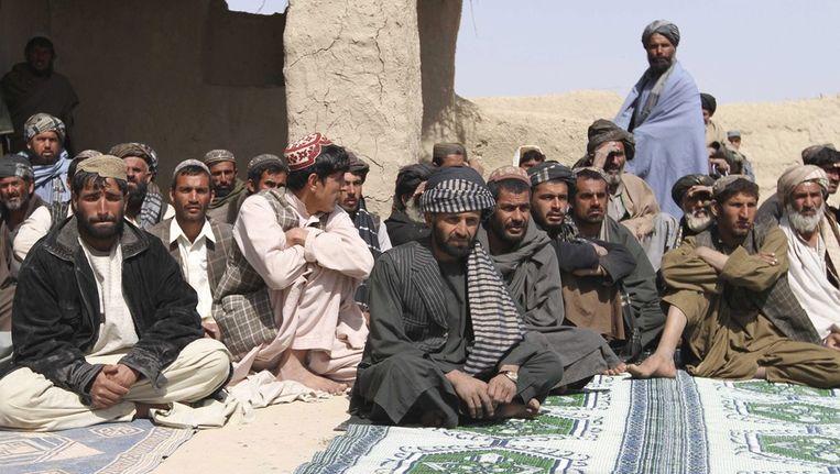 Een herdenkingsdienst in Kandahar voor de slachtoffers van de doorgeslagen Amerikaanse soldaat Beeld epa